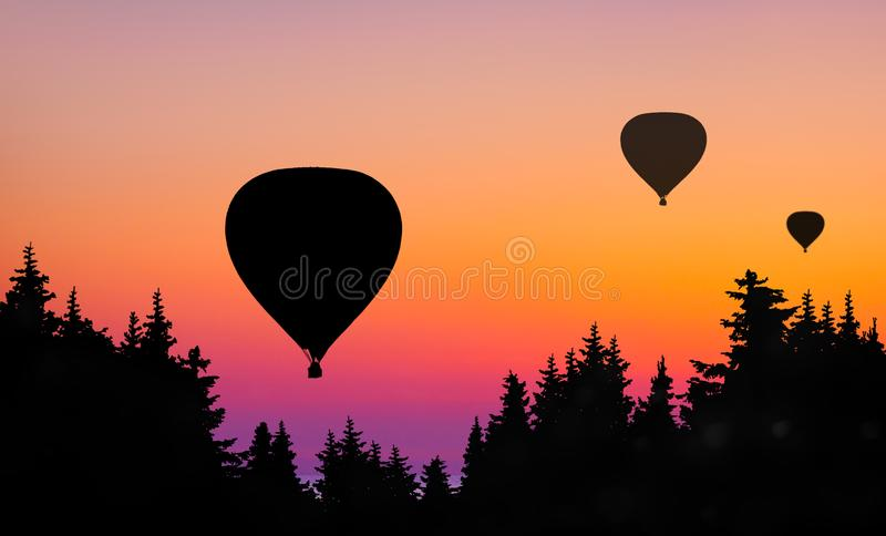 Ballons bij zonsondergang stock foto's