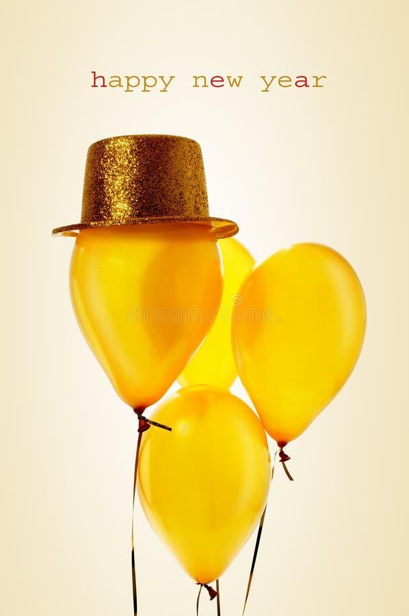 Ballons et bonne année d'or des textes photographie stock libre de droits