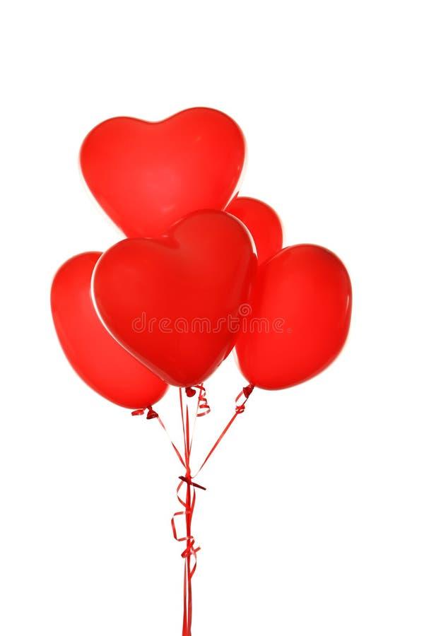 Ballons rouges de coeur d'isolement sur un blanc image libre de droits