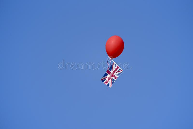 Balloon carries aloft a Union Jack flag from Windsor Castle after the Royal Wedding. Balloon carries aloft a Union Jack flag from Windsor Castle, UK after the stock image