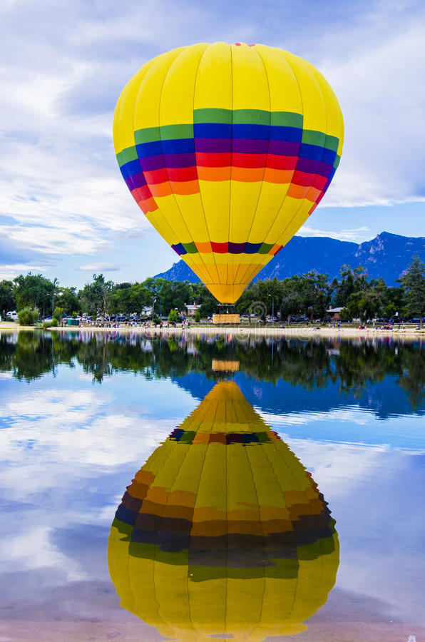 Balloon Festival. Brightly colored hot air balloon against the beautiful blue sky on the ground before take off at the Colorado Springs Memorial Park Lake for royalty free stock image