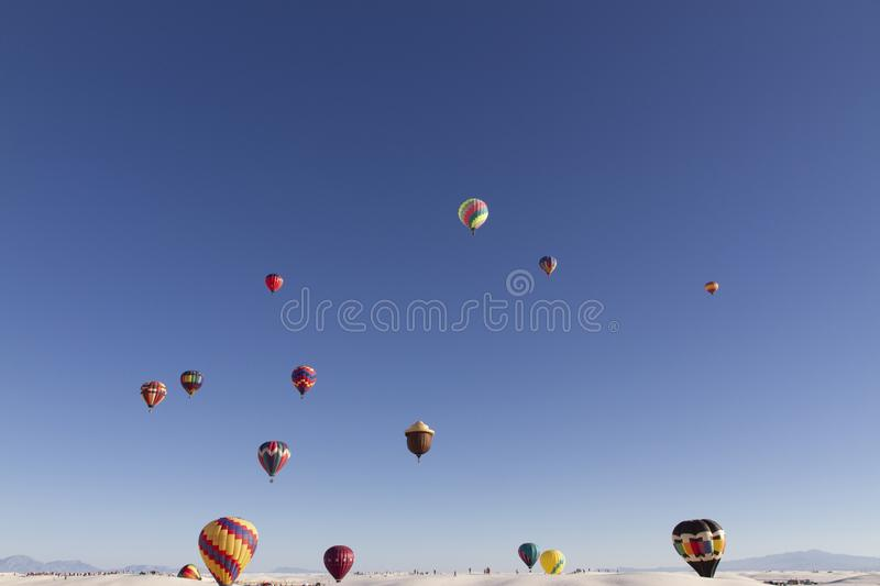 Balloon Fiesta on a sunny day. White Sands National Monument in Alamogordo,New Mexico, USA royalty free stock image