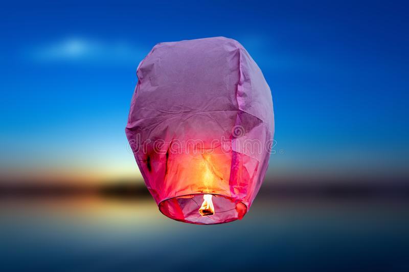 Balloon fire Sky lantern flying lanterns, hot-air balloons Lantern flies up highly in the sky. Sea blur backgrounds royalty free stock image