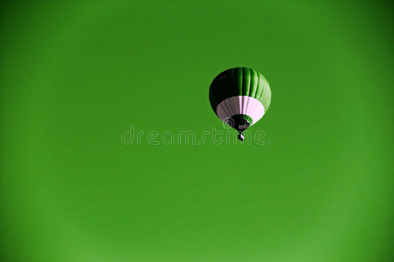 Balloon flight green beckground royalty free stock images