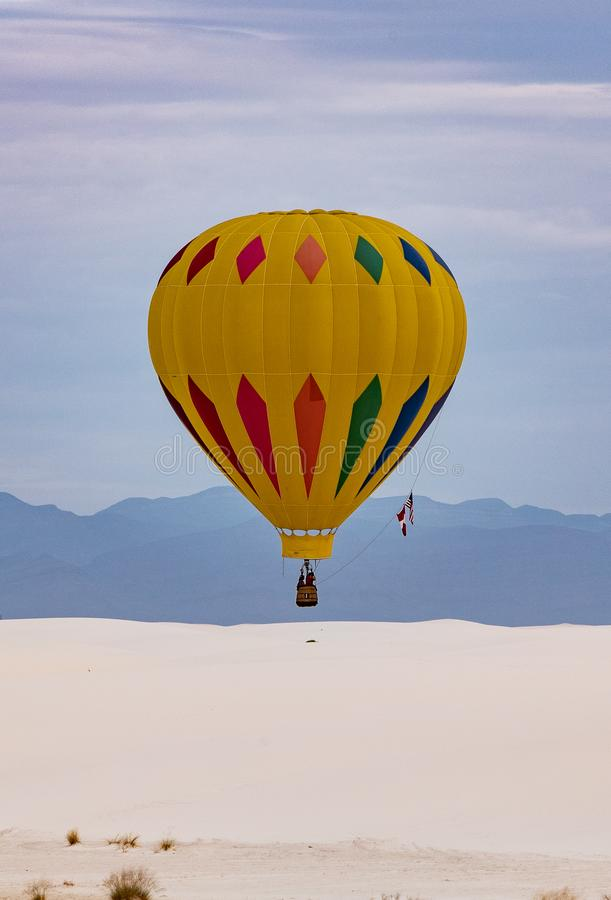 Balloon in flight at White Sands. WHITE SANDS NATIONAL MONUMENT, NEW MEXICO – SEPTEMBER 8.  Balloons in flight during the stock image