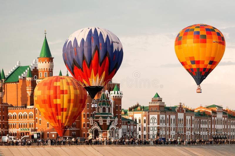Balloon flying over the center of the city stock photos
