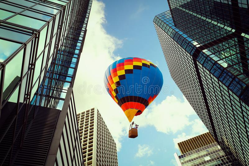 Balloon flying over modern tower building in Hong Kong city down stock photos
