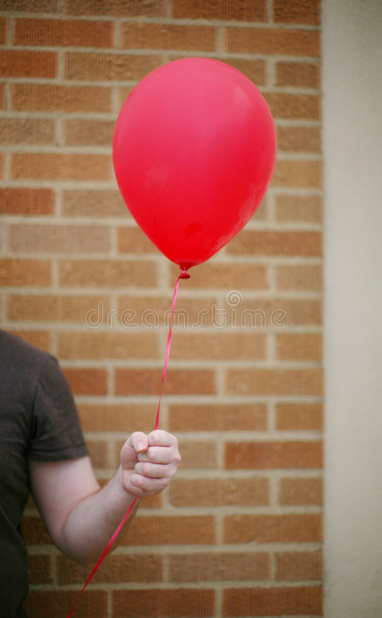 Balloon in hand royalty free stock photography