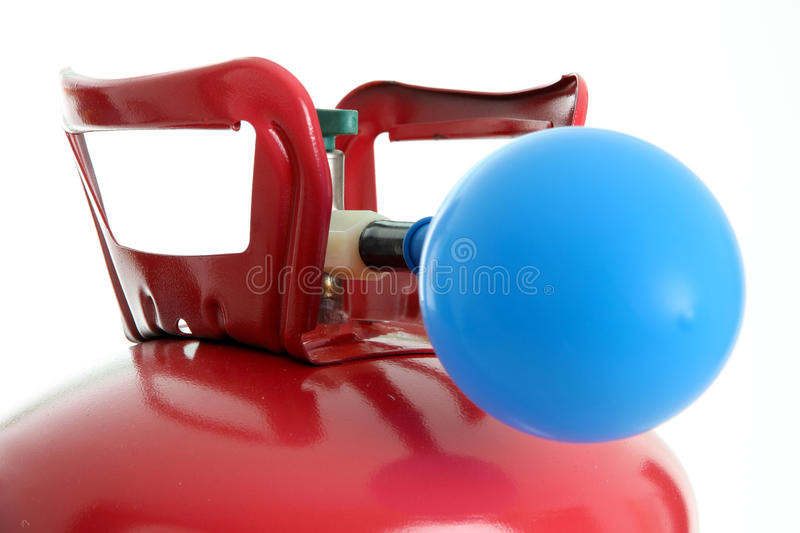 Balloon and Helium. Balloon being filled up by a helium tank stock photo