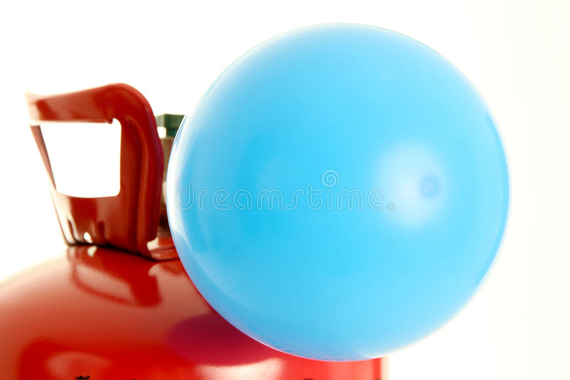 Balloon and Helium. Balloon being filled up by a helium tank royalty free stock photography