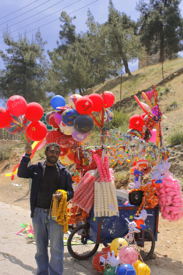 Balloon , ice cream seller in ajloun street in jordan stock photography