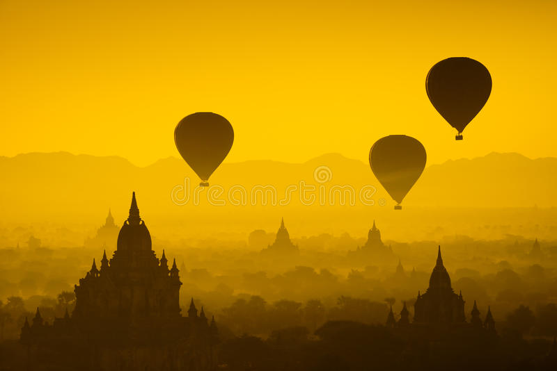 Balloon over plain of Bagan in misty morning, Myanmar royalty free stock photography