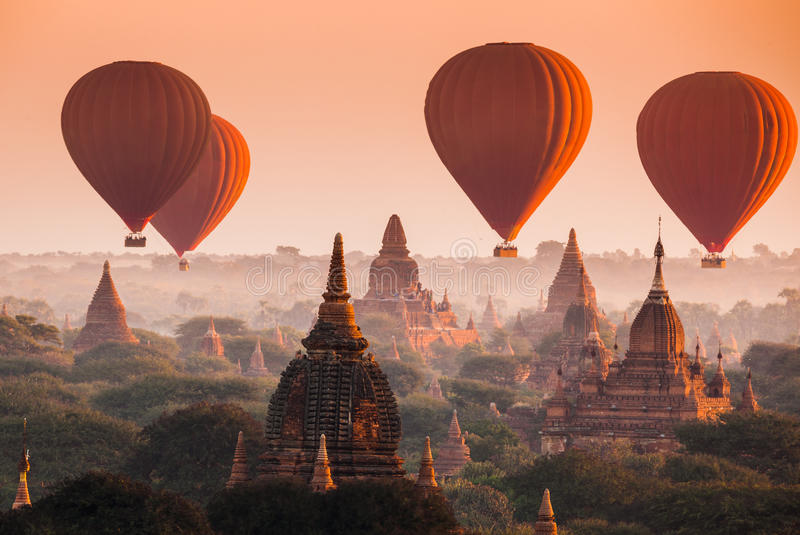 Balloon over plain of Bagan in misty morning, Myanmar. Hot air balloon over plain of Bagan in misty morning, Myanmar stock photos