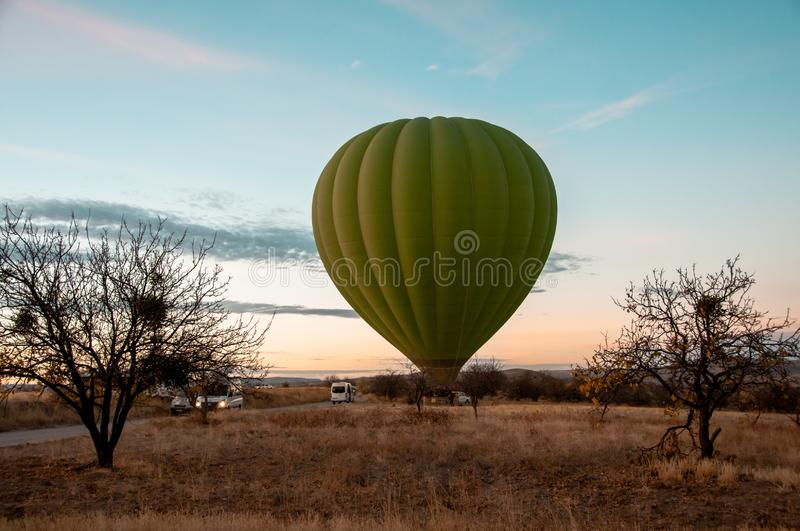 Balloon with passengers on the ground preparing for the flight stock photos