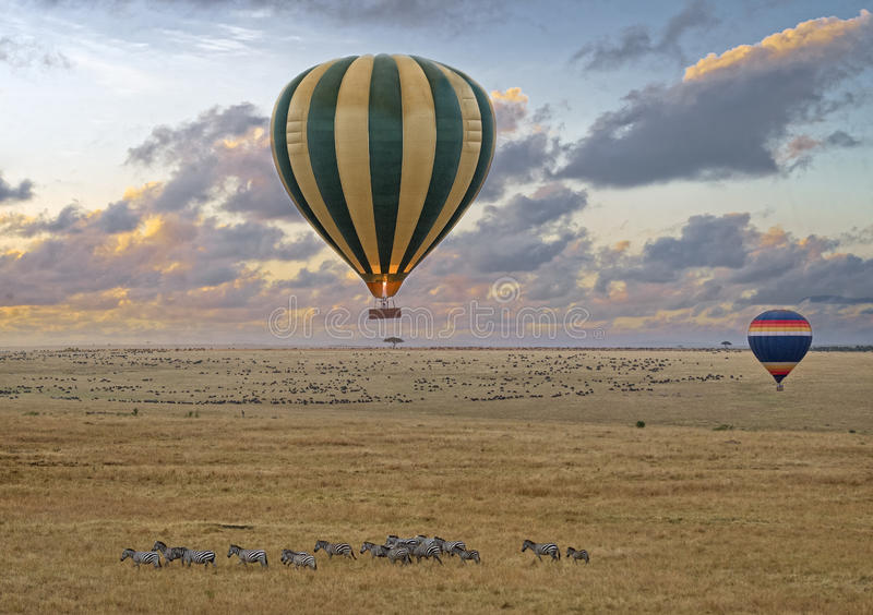 Balloon safari. Hot air balloon safari flight at the time of Great Migration in the magnificent setting of the Great Rift Valley in Kenya stock images