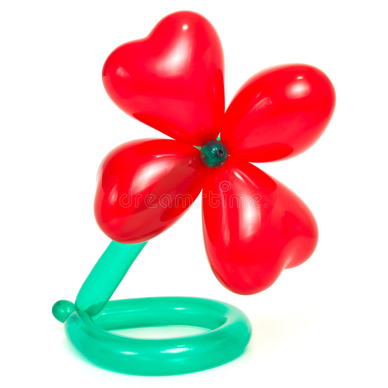 Balloon Sculpture. Flower made from vibrant twisted balloons isolated on white background stock photo