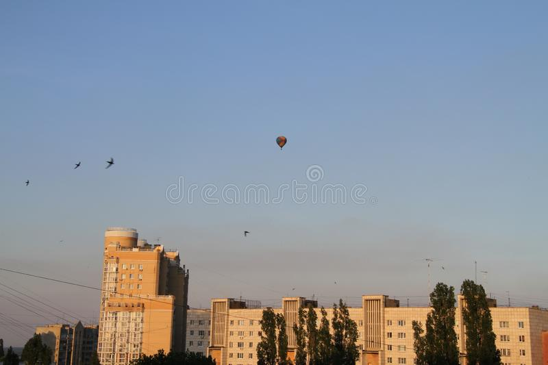 Balloon in the sky over the city stock image
