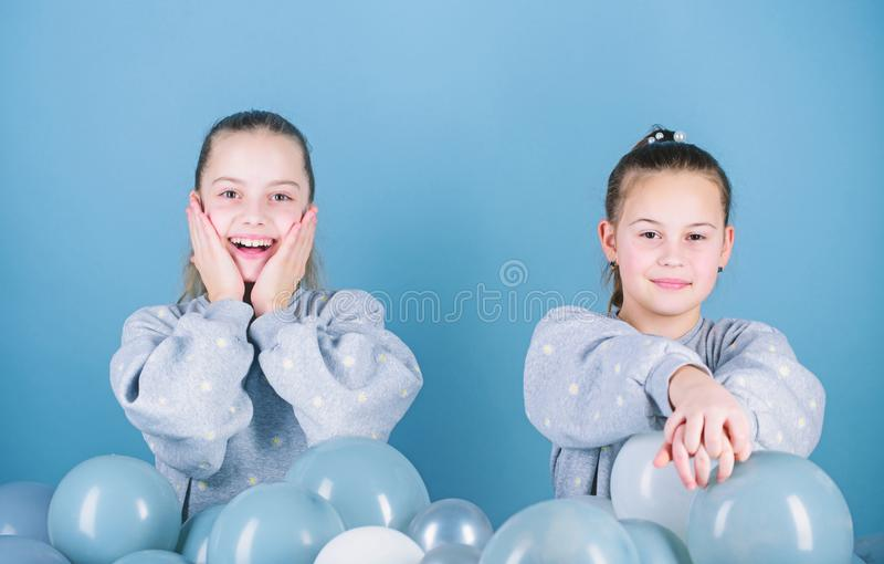 Balloon theme party. Girls friends near air balloons. Start party. Birthday party. International childrens day. Carefree. Childhood. Sisters organize home party royalty free stock photos