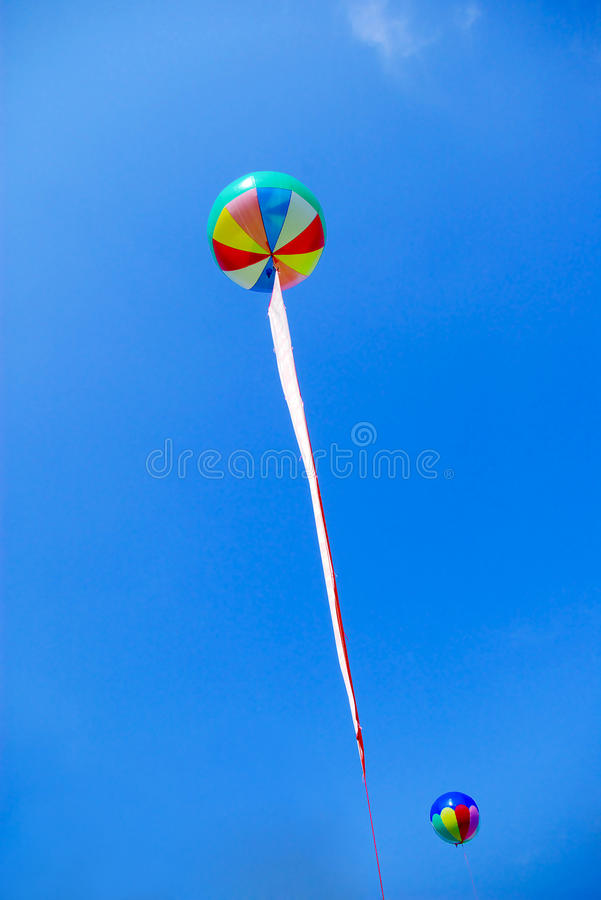 Balloon. Two hydrogen balloons floating in the blue sky royalty free stock photography