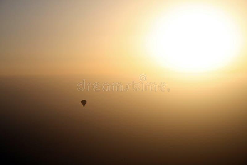 Ballooning in to the sun stock photos