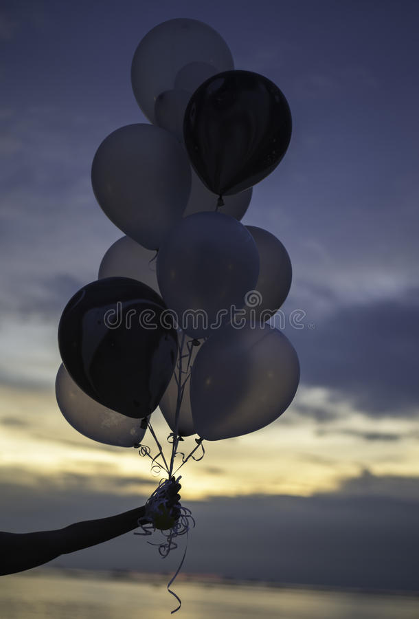 Balloons on the background of sunset sky stock image