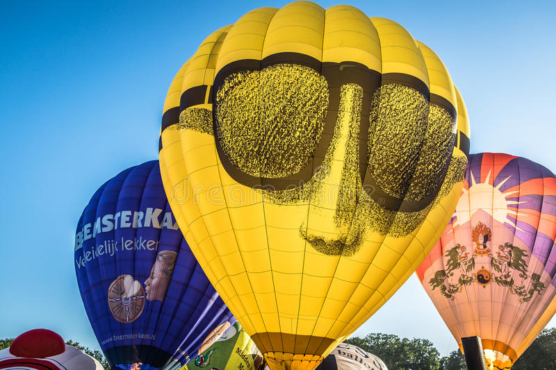 Balloons being inflated at festival, Barneveld, Netherlands. Colorful hot air balloons being inflated for flight in festival in Barneveld, Netherlands against stock image