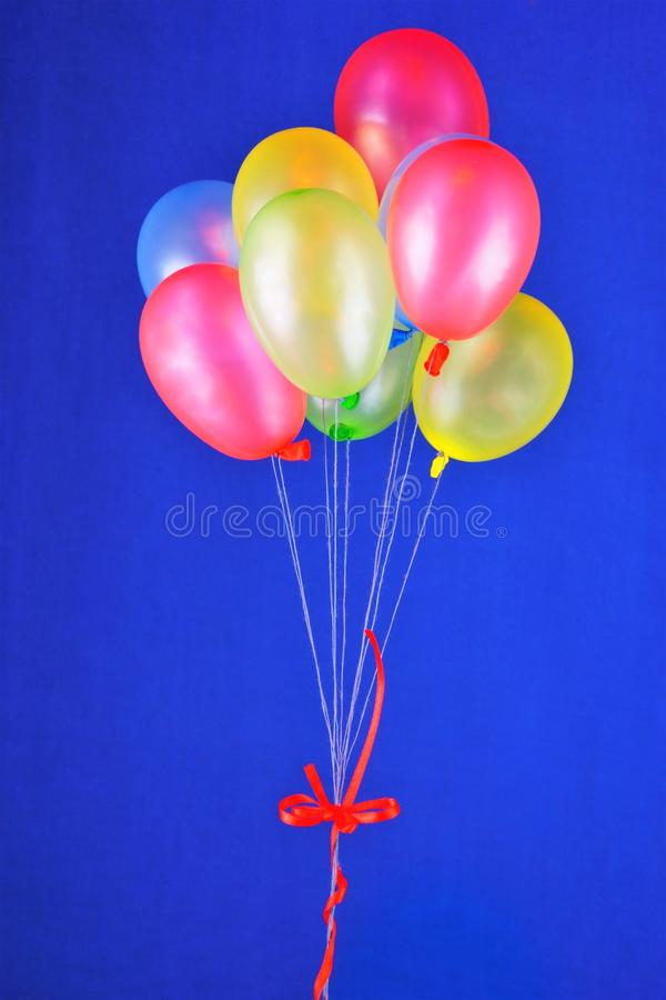 Balloons colorful latex. Colors green, yellow, red, blue-small size. Inflated with air or helium, have the ability to fly. They royalty free stock images