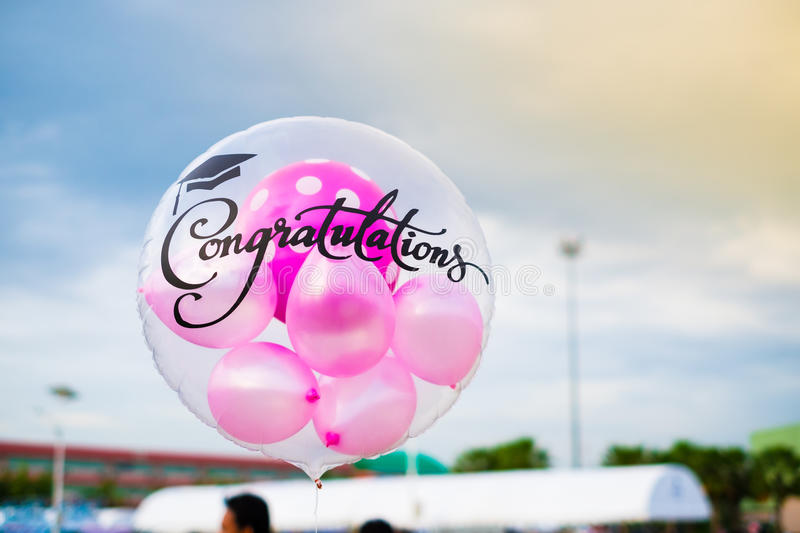 Balloons with congratulations text stock photography