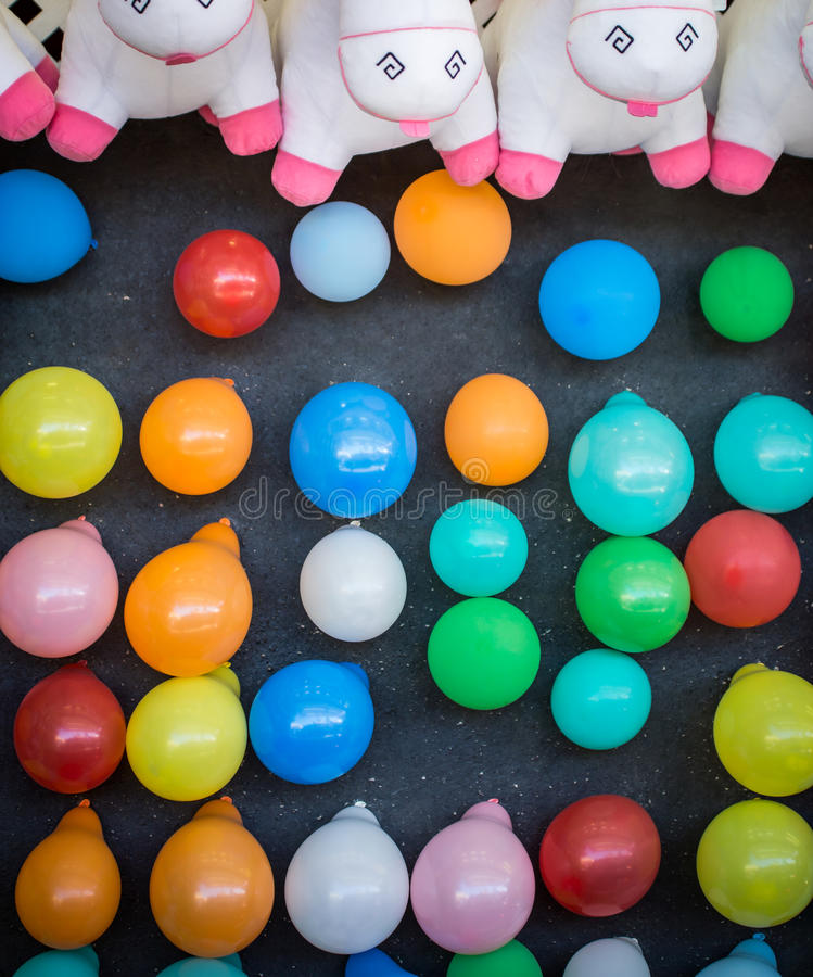 Balloons for Dart Toss. Assorted balloons waiting for a dart to win a prize royalty free stock photography
