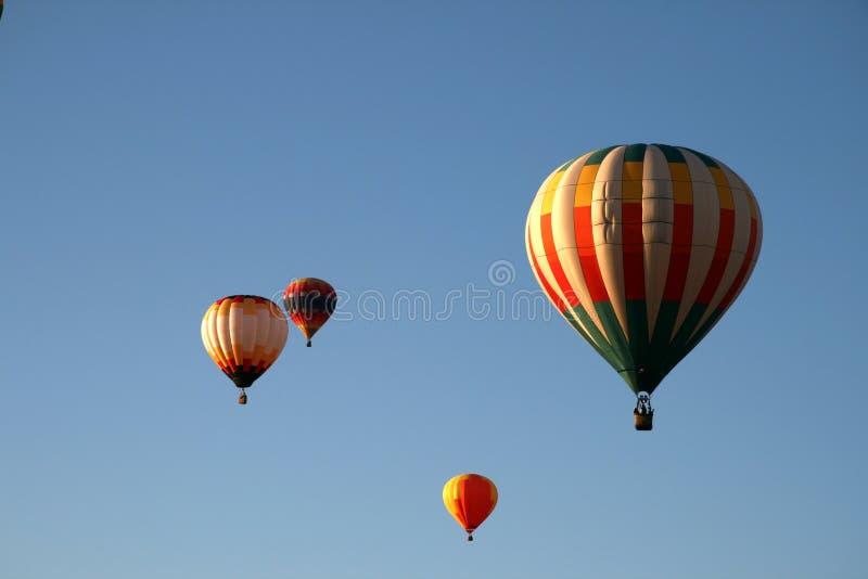 Balloons in flight stock photos