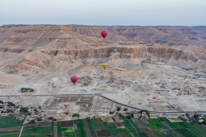 Balloons over Valley of Kings, Luxor, Egypt. Balloons flying over the Valley of Kings at sunrise, Luxor, Egypt royalty free stock photography