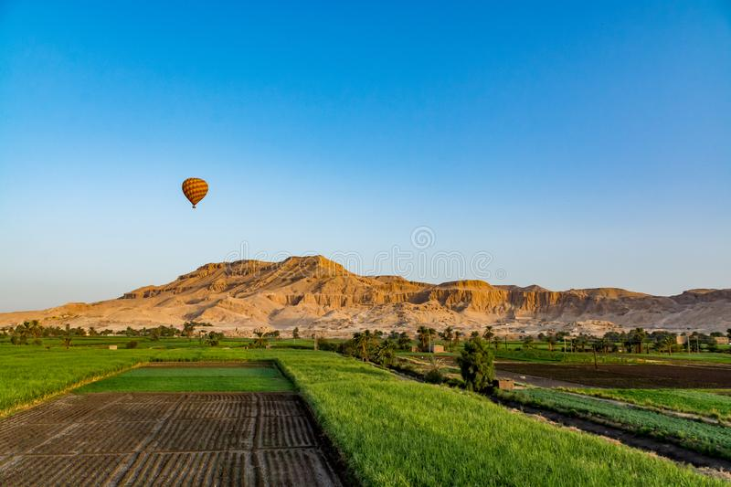 Balloons over Valley of Kings, Luxor, Egypt. Balloons flying over the Valley of Kings at sunrise, Luxor, Egypt stock photo