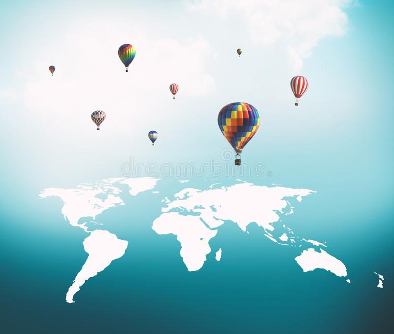 Balloons flying over world map royalty free stock image
