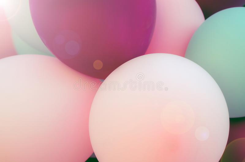 Balloons with helium. Balloons of light, purple and pink colors. holiday atmosphere. anniversary celebration, wedding, valentines royalty free stock photos