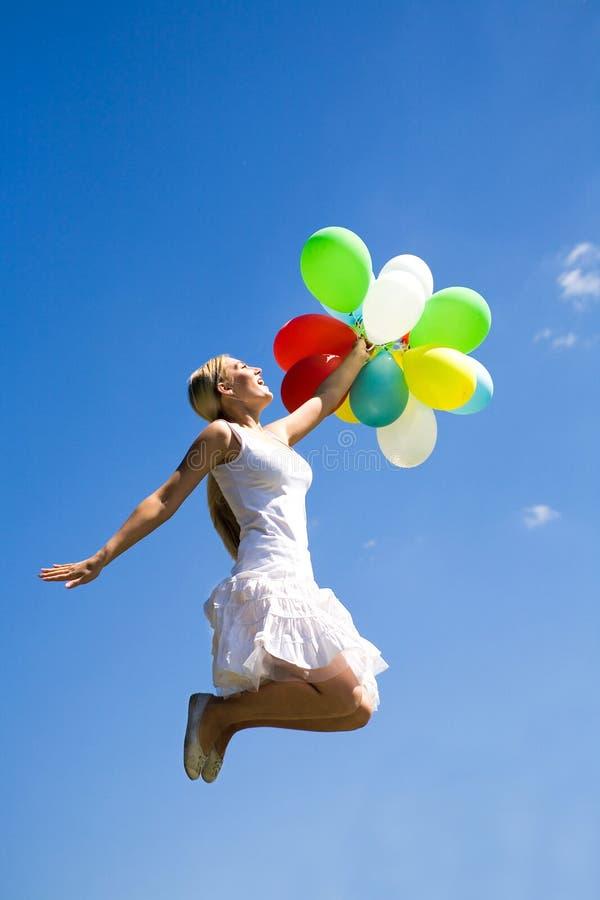 balloons la donna di salto immagine stock