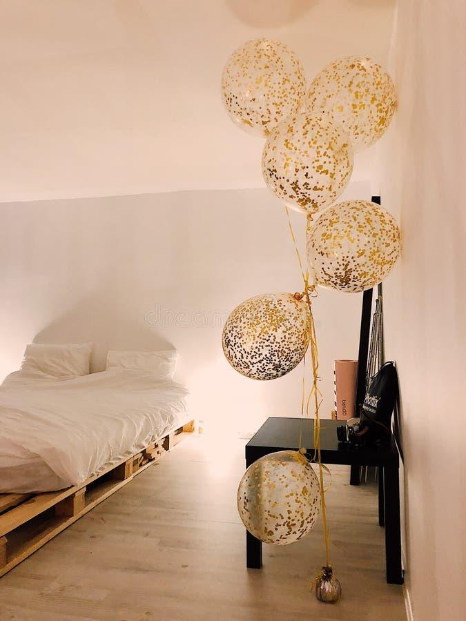 Balloons Near White Bedspread Set royalty free stock photo