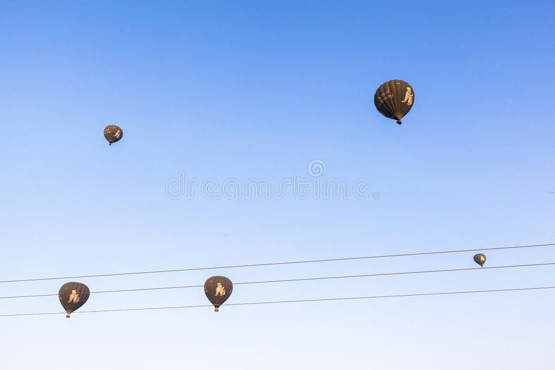 Balloons over Bagan at sunrise with horses stock photo