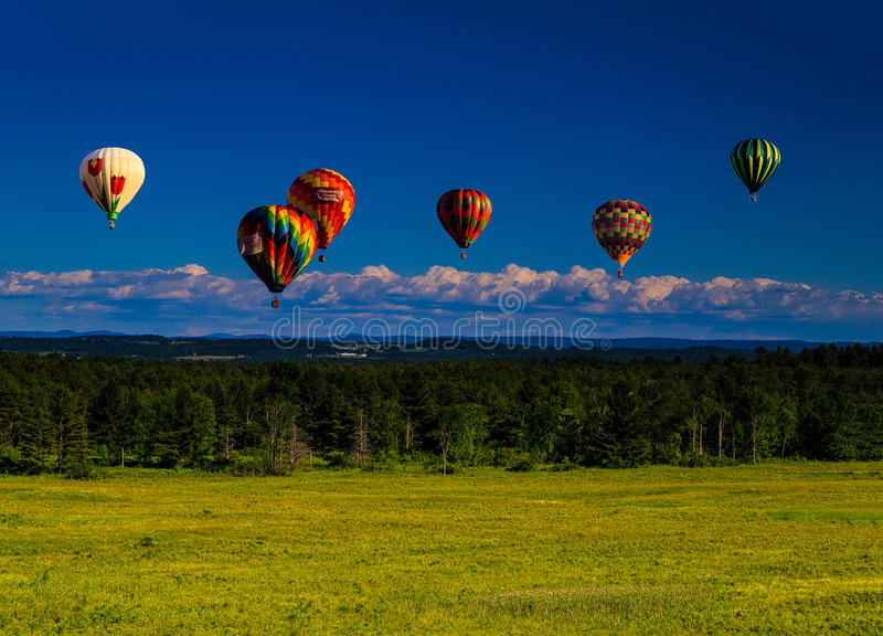 Balloons over Saratoga mid afternoon overlooking Berkshires royalty free stock photo