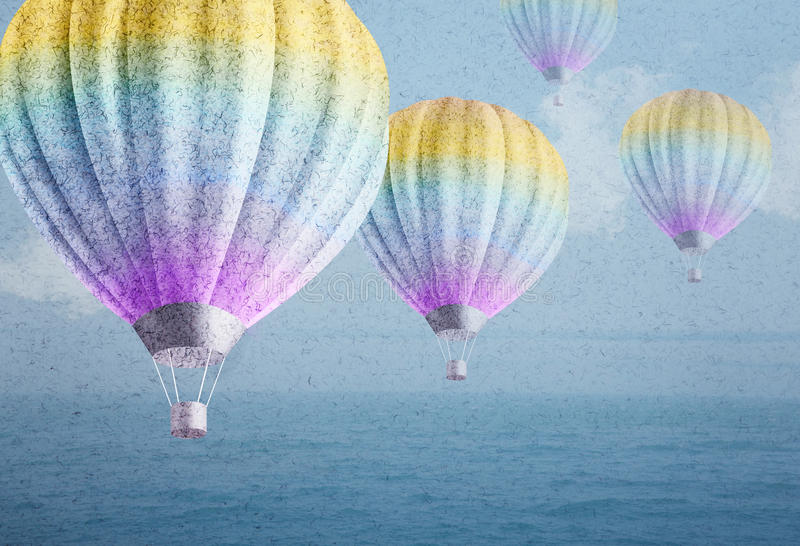 Balloons over watercolor sea landscape paper grunge background stock photos