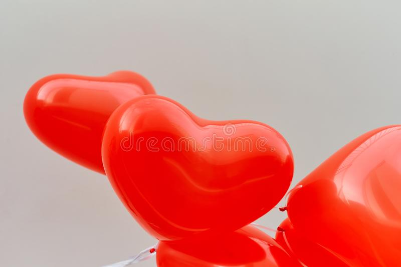 Balloons red heart on a white wall background. royalty free stock photo
