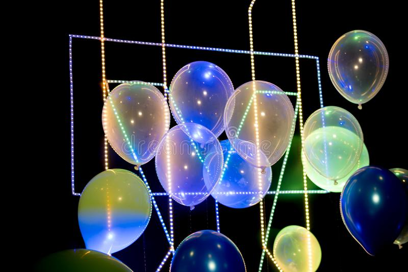 Balloons with strip led light on black background royalty free stock image