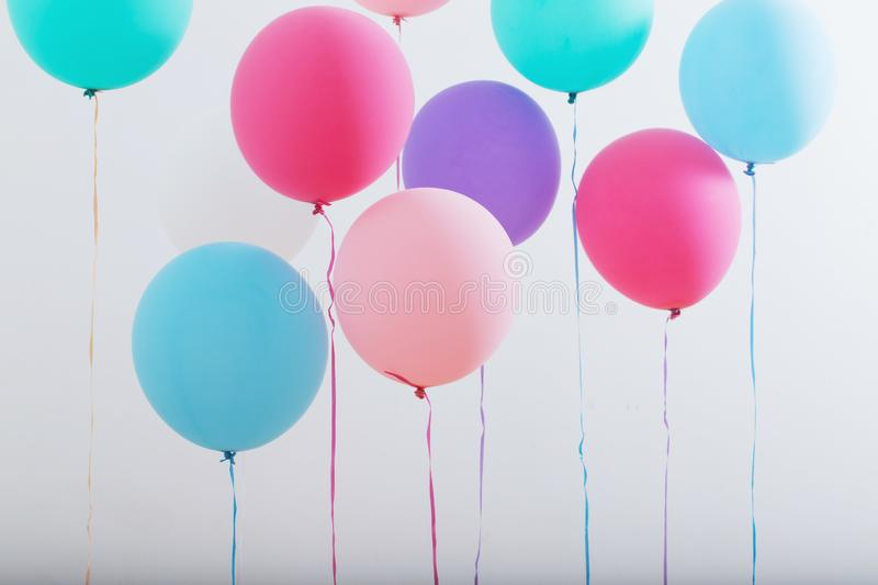Balloons on white wooden background royalty free stock image