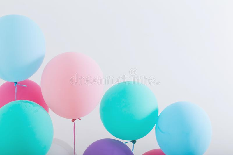 Balloons on white wooden background royalty free stock photography