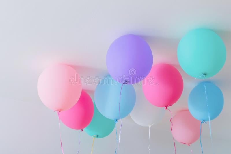 Balloons on white wooden background royalty free stock images