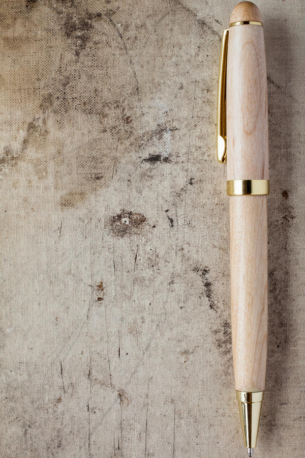 Ballpen on grunge background. Ballpen with copy-space on old canvas grunge background royalty free stock image