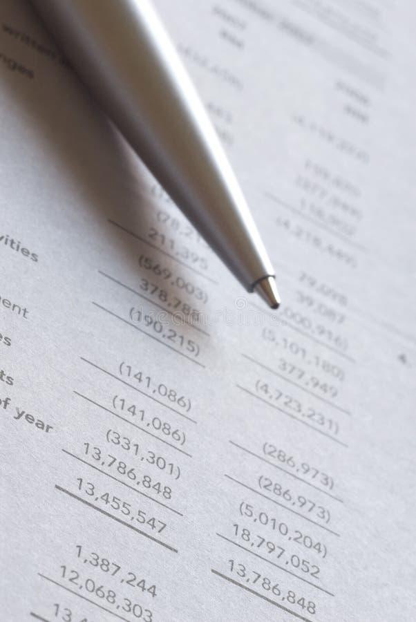 Ballpoint pen on financial figures stock photography