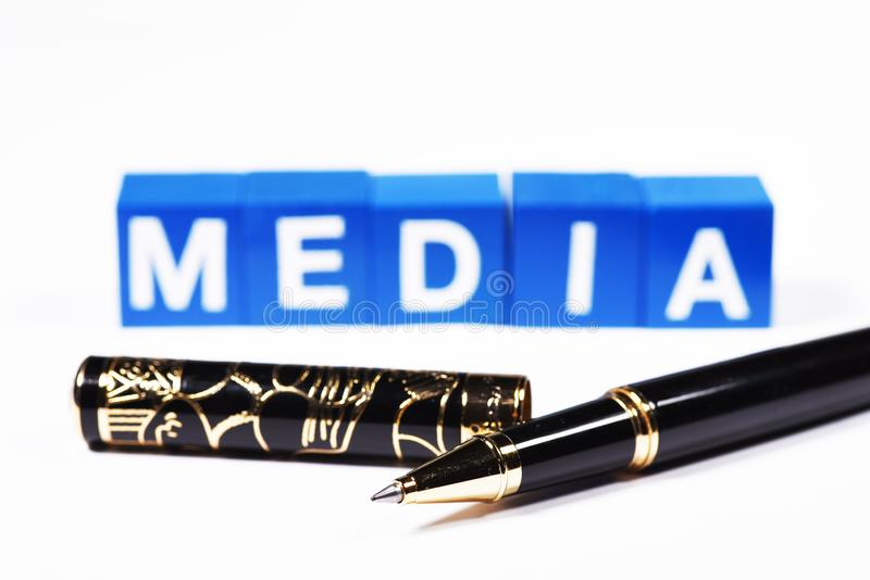 A fancy ballpoint pen in front of the word `media` royalty free stock photos