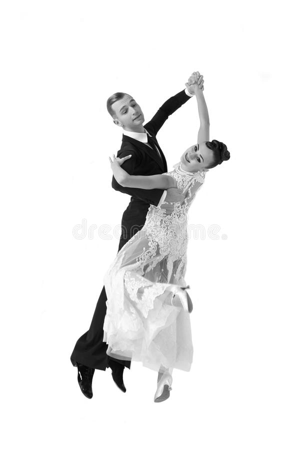 Ballrom dance couple in a dance pose isolated on white bachground. Beautiful ballroom dance couple in a dance pose isolated on white background. sensual royalty free stock images