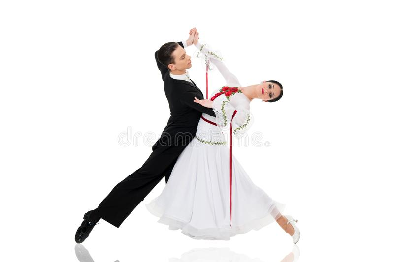 Ballroom dance couple in a dance pose isolated on white background. ballroom sensual proffessional dancers dancing walz. Ballroom couple. ballroom dance couple stock photography