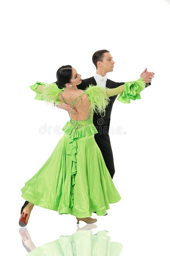 Ballroom dance couple in a dance pose isolated on white background. ballroom sensual proffessional dancers dancing walz. Ballroom dance pose. ballroom dance royalty free stock image